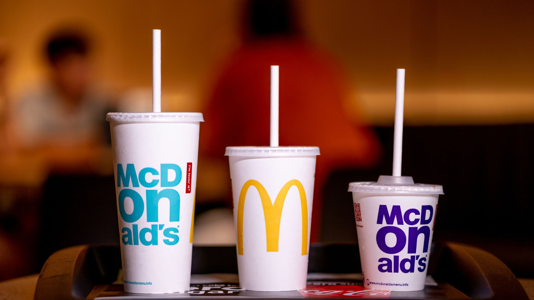 McDonald's workers share what the 'buttons' on its drink lids really mean