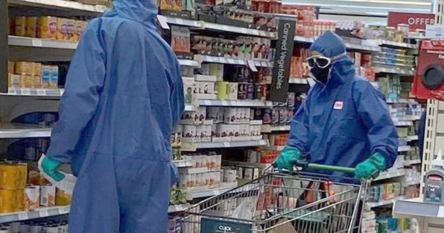 Couple spotted at Waitrose in full hazmat suits, rubber gloves and goggles