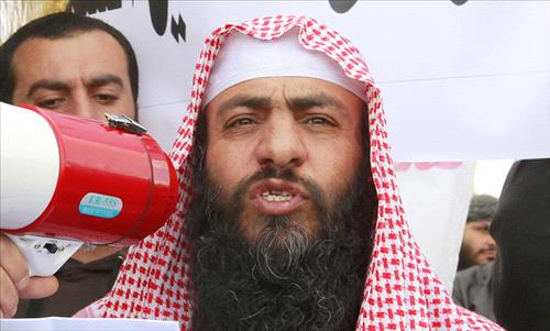 Salafist jihadist leader Abu Sayyaf speaks to his supporters and the media during a demonstration REUTERS/Muhammad Hamed