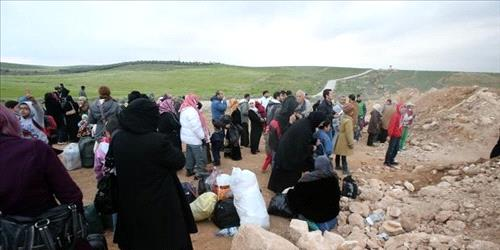 Families with children among those blocked from crossing into Jordan to flee the fighting in Syria. (Getty Images)