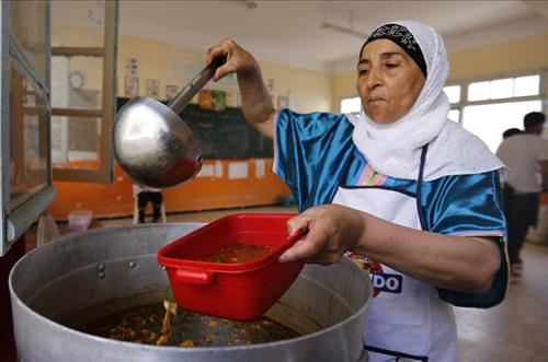 A cook serves up soup at a Ramadan charity tent outside Algiers (photo: Reuters)