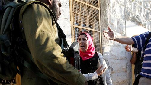 Army: Palestinian woman attacks soldier with knife